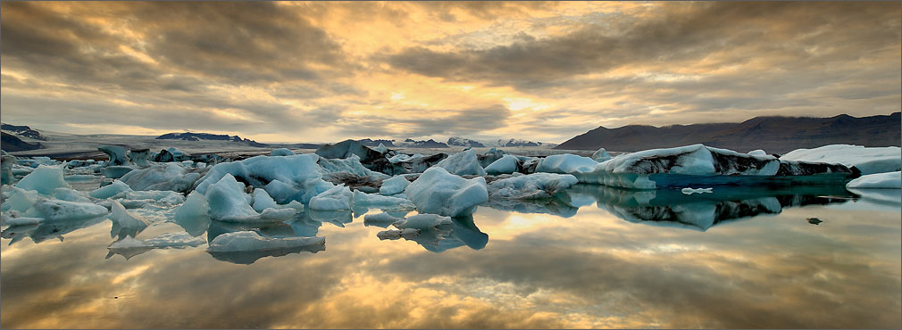 The Iceland Jokulsarlon lagoon with icebergs at sunset