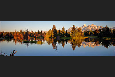 The Grand Teton Range of the Rocky Mountains in Wyoming is mirrored in Oxbow Bend at Schwabachers Landing near Jackson Hole